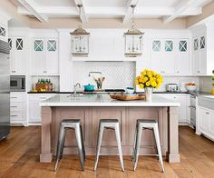 White & bright kitchen with amazing lantern fixtures | via BHG.com