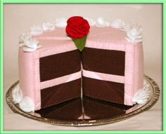 Wool Felt Play Food - Chocolate Cake Slice with Pink Frosting. $35.00, via Etsy.