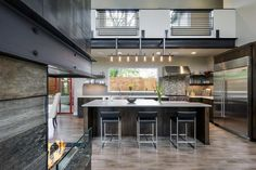 Perched atop a hill at the end of a street, this 3,300-square-foot home designed…