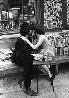 black and white kiss in font of a bookstore; couple kissing, kisses, love.  Reading is Sexy.