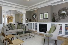 Love this living room. Paint color is: Benjamin Moore, Mesa Verde Tan, flat lat