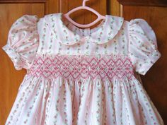 Baby girl hand smocked dress pink and white floral stripe Size 3Months. $40.00, via Etsy. Reminds me of Ralph Lauren