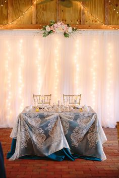 Sweetheart Table with Blue Lace Tablecloth   Photo: KT Crabb Photography