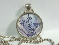 """Resin necklace with the words """"book boys are better .""""  Book Lovers will love this !! *on a 24 inch chain"""