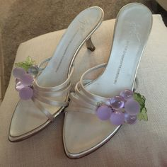 Giuseppe zanotti silver sandals size 7 1/2 Giuseppe zanotti designer silver low heel slides simple elegance . Low heel for comfort but still stylish . Adorned with lavender glass grapes in the front so cute ! Ladies size 7 1/2 Giuseppe Zanotti Shoes Sandals
