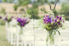 wedding ceremony aisle decor: shepherd's hooks and wildflower arrangements that…
