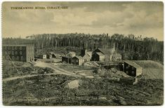 An image of a postcard in sepia tones showing the Temiskaming Mines in Cobalt, ca. 1905