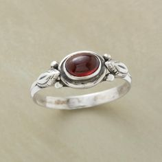 LEAFY GARNET RING--As pretty as a rose in bloom, our garnet cabochon likewise rises from a leafy setting. A handcrafted exclusive in sterling silver. Whole sizes 5 to 10.