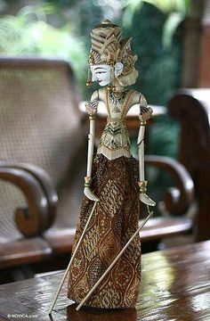 Really cool! Brave Rama appears in poised in a handcrafted wayang golek (rod puppet) by Nono Supriatna. He carves it from albesia wood and uses oils to paint the puppet with expressive detail. His elegant sarong is adorned with beads and batik motifs, his regal crown is impressive. Lord Vishnu's seventh reincarnation, Rama is the hero of the Ramayana, the Hindu epic legend that tells of his trials and tribulations, including the rescue of his wife, Sita, from an evil king. NOVICA