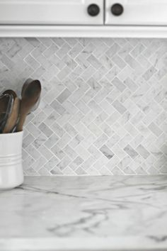 gray and white herringbone backsplash