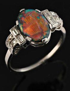 An Art Deco opal and diamond ring