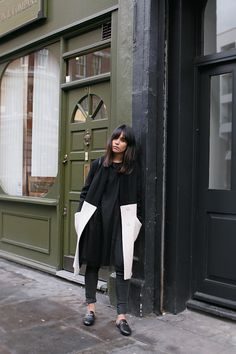 Nisi is wearing: Gucci Princetown slipper, Üterque two-tone coat, black mesh dress, skinny jeans - teetharejade.com