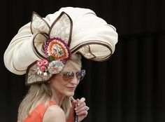A woman wears a fancy hat at Churchill Downs in Louisville before the 138th running of the Kentucky Derby.