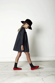 Black long sleeve dress. Black hat and Ted flats. The perfect outfit for little girls