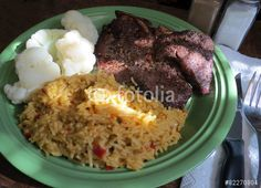 A meal of broiled steak, Mexican rice and cauliflower.