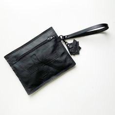 Excited to share this item from my #etsy shop: Black clutch, black leather clutch, wristlet clutch, Christian, religious, abstract , soft leather clutch, crucifix, cross #black #gothic #unique #artisan #sustainable #eco Black Clutch, Leather Clutch, Soft Leather, Black Leather, Crucifix, Artisan, Tassel, Craftsman