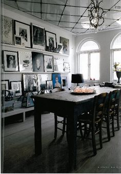 Wall of pictures and deeper shelf for glass display boxes. Home of fashion designer Malene Birger (Day & Birger) Similar shelving is used throughout the house to display artwork.