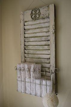 love. love. love it...vintage shutter w/ shelf!