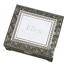 "This beautiful ornate 4.5"" x 5"" x 2.25"" footed box has a non-tarnish antique finish and hinged cover. The box and cover have a dark blue flocked cloth lining. The cover has a plain area approximate 2.5"" x 3"" that can be used to engrave a special message, monogram, or initial. White gift box."