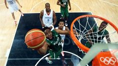 Ike Diogu of Nigeria drives for a shot attempt in the second half against France during the men's Basketball Preliminary Round match on Day 10.