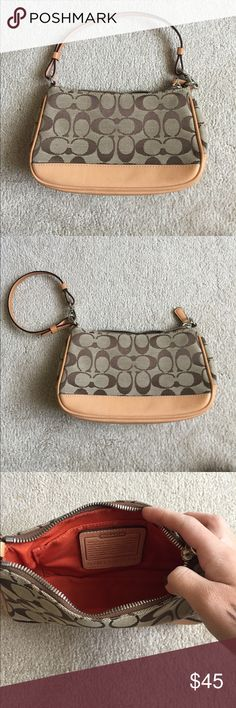 Coach Small Purse / Wristlet In amazing condition. Beautiful! Goes with anything. 100% authentic. 8.5 in length, 5 in. height, 2.5 in. width at base. Coach Bags