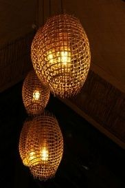 Island chic - traditional Fijian fish traps being used as pendant lights in the bar at Musket Cove Island Resort, Fiji