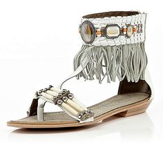 update your sandals collection with these white fringe and embellished sandals