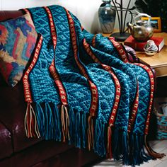 Leisure Arts - Tribal Spirit Cover-Up Crochet Pattern ePattern, $4.99 (http://www.leisurearts.com/products/tribal-spirit-cover-up-crochet-pattern-digital-download.html)