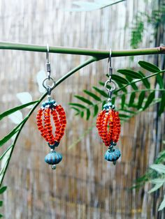 Orange and Teal/Aqua Seed Bead by IntuitiveAdornments on Etsy https://www.etsy.com/shop/IntuitiveAdornments