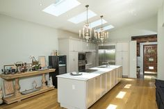 The airy kitchen at Mission House is illuminated by skylights in a vaulted ceiling.