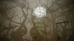 Chandelier casts a fantasy forest of shadows against the walls