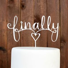 """Stamp Out custom cake toppers are a dollop of DIY and a wallop of WOW! Made of MDF wood and white on one side—toppers come ready for you to paint and finish however you like. Approximate size: 8.5"""" x"""