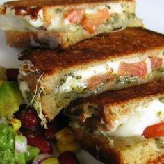 Mozzarella, Tomato, Pesto, Grilled Cheese with avocado. This looks stupid good.