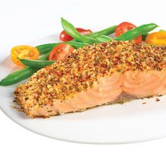 Irresistible baked salmon seasoned to perfection with all natural tomato, basil and other spices can be ready in less than 20 minutes. Complete the meal with a colorful sauté of green beans and cherry tomatoes.