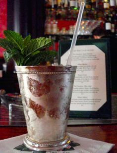 The Greenbrier's Original Mint Julep!  Muddle 12-15 fresh mint leaves with 1 ounce of simple syrup. Fill cup with crushed ice (very important) and add 2 ounces of Woodford's Reserve Bourbon. Stir once or twice and add a sprig of mint dusted with powdered sugar.