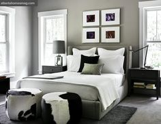 black and white cowhide ottomans, gray wingback bed, gray bedroom - Modern bedroom with black grey pillows Black White And Grey Bedroom, Bedroom Black, Monochrome Bedroom, Modern Bedroom Design, Contemporary Bedroom, Bedroom Designs, Modern Contemporary, Style At Home, Home Bedroom