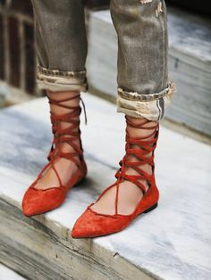 Red suede pointy-toe lace up flats by Jeffrey Campbell