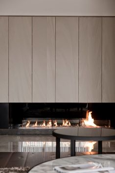 Like the cabinetry above this fireplace by DA Interior Taiwan Home Fireplace, Modern Fireplace, Living Room With Fireplace, Fireplace Design, Fireplaces, Home Living Room, Interior Design Living Room, Modern Interior, Living Tv