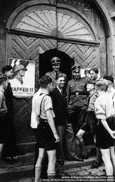 Waffen SS recruiters with volunteer and admiring Hitler Youth members. Toward the end of the war, SS, i.e. Gottlob Berger did everything to enlist and recruit among HJ, the Hitler Youth organized a Waffen SS division that was decimated in the closing battles of the war.