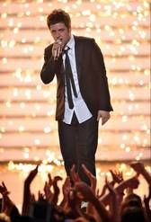 """Lee DeWyze performs onstage at the """"American Idol"""" finale in 2010. The season nine winner will perform on the Fox show Thursday."""