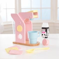 """It's time to brew up some fun and excitement with our interactive Wooden Coffee Set. This brand new design has a bold, modern look - the traditional coffee pot has been replaced by an on-the-go cup and convenient """"pods."""" There's even a water reservoir that attaches to the back, giving kids yet another realistic way to pretend they're really making some fresh coffee."""