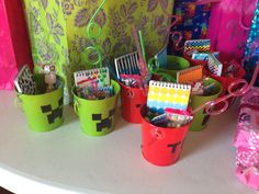 Minecraft party favors made with pail and a sharpie for Abriels 6th Birthday Party! TNT on the red ones and a Creeper face on the green ones