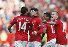 Rooney celebrates his equaliser with Javier 'Chicharito' Hernandez and Alex Buttner
