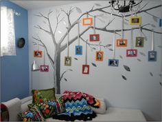 family tree painted on wall with picture frames