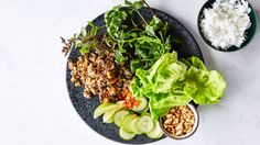 Larb is hailed as the national dish of Laos. Traditionally the salad starts with extremely finely chopped lean meat or fish and is seasoned with lime juice, chiles, fish sauce, and toasted ground rice. This recipe calls for ground lamb, a fattier protein than what's usually used, and subs ground peanuts as a nod to the texture of the rice.