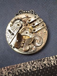 Butterfly Steampunk pocket watch handcrafted by VictorianMagpie
