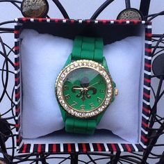 Green & Gold Fleur de Lis watch Cute Green & Gold rubber band watch with gold Fleur de lis inside face embellished with Rhinestones!! Nice casual accessory to pair with an inspirational T-Shirt top. NIB Discounts available---Offers Welcomed Accessories Watches