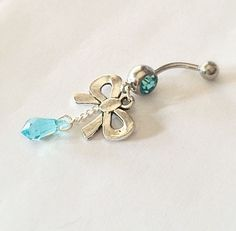 Check out Blue Bow Crystal Belly Piercing Ring on Threadflip!