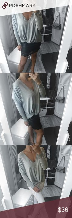"""🆕 Heather Gray Relaxed Dolman Style Top A fun and easy top that is perfect all season long! Wear it with your favorite jeans for a casual put together look, or dress it up with a skirt or pants.   ▪️COLOR : Heather Gray ▪️FABRIC: Modal Jersey ▪️CONTENTS : 95/5 Modal Spandex  ▪️MEASUREMENTS: Size small 25"""" - 27 """" total lenght  ▪️DETAILS: relaxed fit, twisted knot, dolman style , hem detail , made in USA   ▫️Modeling Small  : I'm 5' 5"""" and 129 lbs  ( bust 34 
