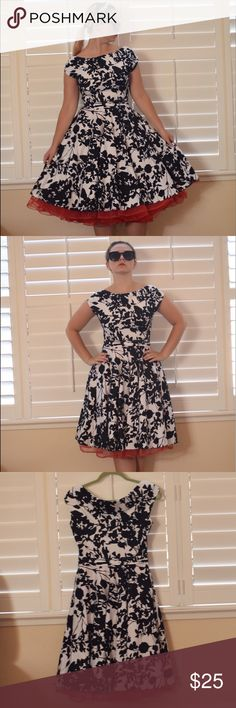 Patterned Dress with Red Ruffles Worn once. Perfect condition. This dress really makes you feel glamorous as you channel Audrey Hepburn. I like to put a red petticoat under it for some extra fluff. Dresses Midi